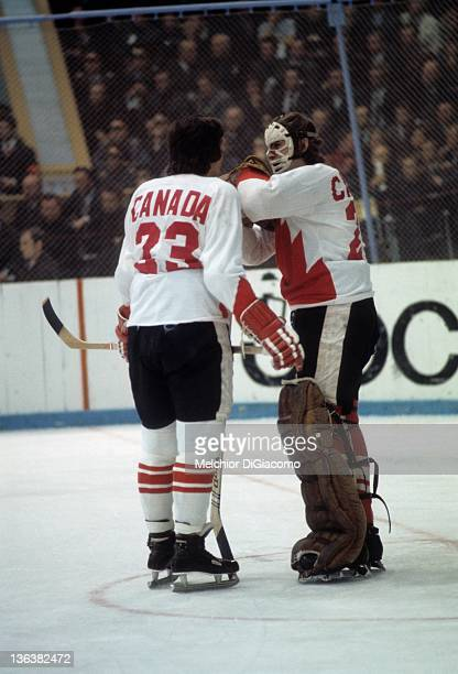 Serge Savard of Canada talks with goalie Ken Dryden during their game against the Soviet Union in the 1972 Summit Series at the Luzhniki Ice Palace...