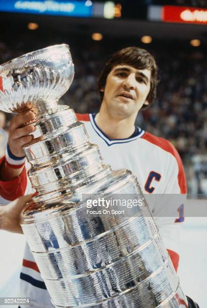 Serge Savard of the Montreal Canadiens holds the Stanley Cup Trophy after defeating the New York Rangers in Game 5 of the Stanley Cup Finals on May...