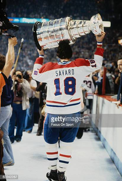 Serge Savard of the Montreal Canadiens holds the Stanley Cup Trophy and skates around after defeating the New York Rangers in Game 5 of the 1979...