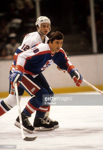 Serge Savard of the Winnipeg Jets skates on the ice as Duane Sutter of the New York Islanders defends during their game on December 22 1981 at the...