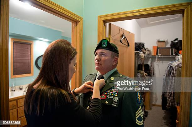 Sergeant 1st Class Matthew Bessler, a retired US Special Forces K-9 handler, dresses in his military uniform prior to honoring his war buddy, Major...