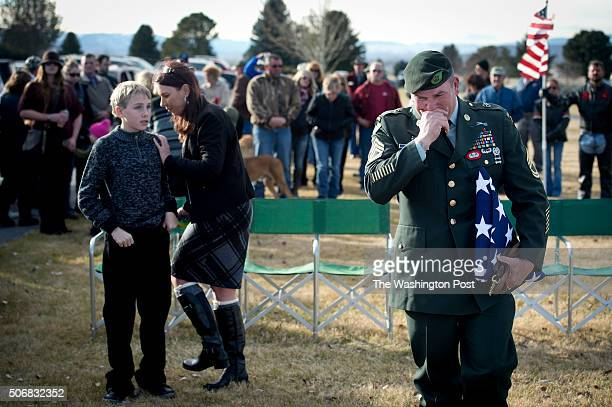 Sergeant 1st Class Matthew Bessler, a US Special Forces K-9 handler, weeps as he approaches the grave marker of his war buddy, Major Mike, a...