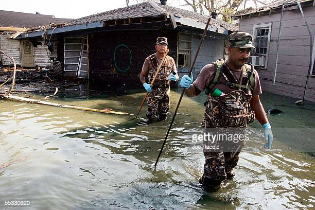 Sergeant 1st Class Uranga Pete and Staff Sergeant Paul Miera from the New Mexico National Guard check for bodies in homes destroyed after Hurricane...