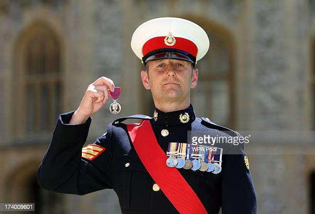 Sergeant Anthony Russell after he received the George Cross from Queen Elizabeth II during an Investiture ceremony at Windsor Castle on July 19 2013...