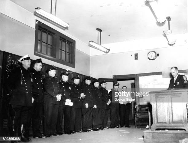 Sergeant Arthur Horick presides over the last roll call at Boston Police Station 17 in the West Roxbury neighborhood of Boston on Nov 20 1964 The...