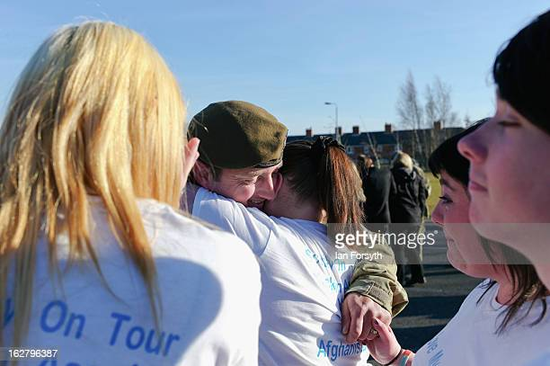 Sergeant Brian Scott greets his partner Amanda Leghorn and other family members as soldiers from Headquarters Company 1st Battalion The Scots Guards...