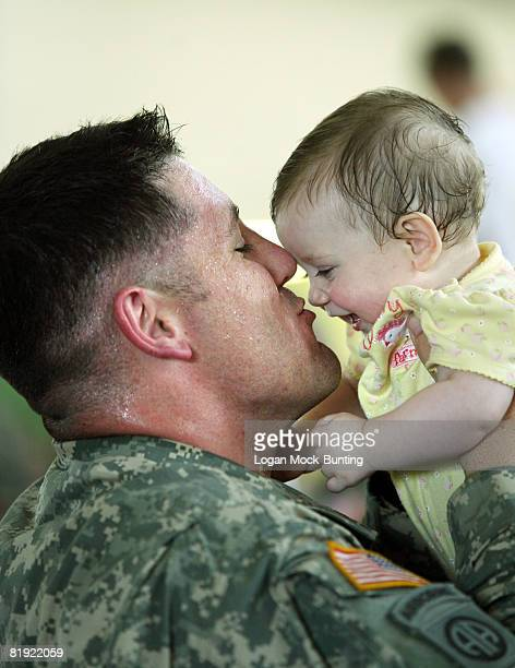 Sergeant Christopher Smith is greeted by his 8 month old daughter Kayden Smith as they return to Fort Bragg July 13, 2008 in Fayetteville, North...