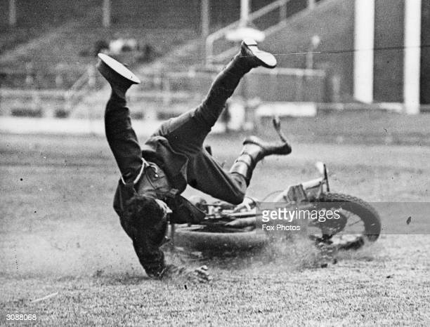 Sergeant Cupitt leaps towards a motorcycle which has lost its rider and is careering riderless towards onlookers at a meet in Sydney Australia March...