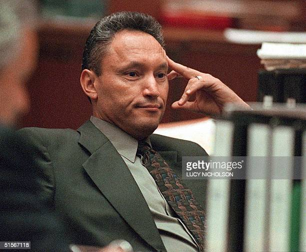 Sergeant Edward Ortiz reacts to defense crossexamination of witness Veronica Polanco at the Los Angeles Police Department Rampart division corruption...