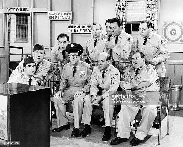 Sergeant Ernie Bilko played by American comedian Phil Silvers watches television with his men in the US TV sitcom 'The Phil Silvers Show' circa 1957...