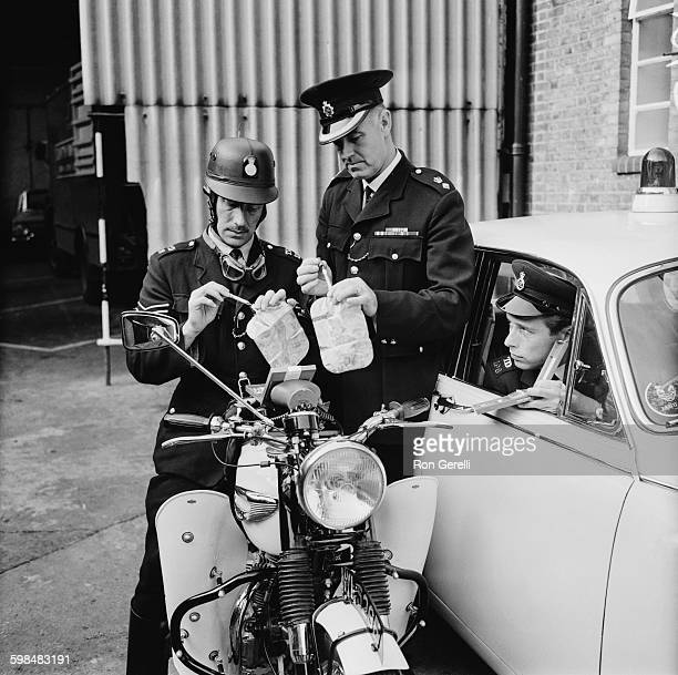 Sergeant Furner Superintendent W Fleming and PC D Preedy testing breathalysers at Southwark Police Station London UK 6th October 1967