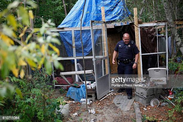 Sergeant Hutchings of the Portland Police Dept knocks on a door of a cabin in the homeless encampment behind Pine Tree Shopping Center to check if...