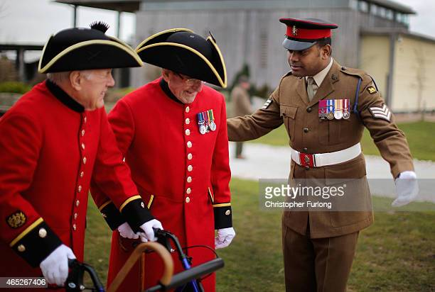 Sergeant Johnson Beharry VC chats to Chelsea Pensioners Clive Baker and Ron Cutlin at The National Memorial Arboretum before the unveiling of a...