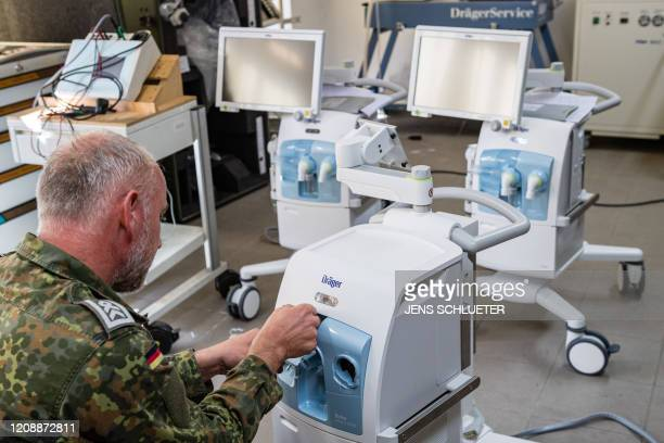 Sergeant major Andre Rose checks and prepares intensive care ventilators on April 1 2020 at the German armed forces Bundeswehr's supply and repair...