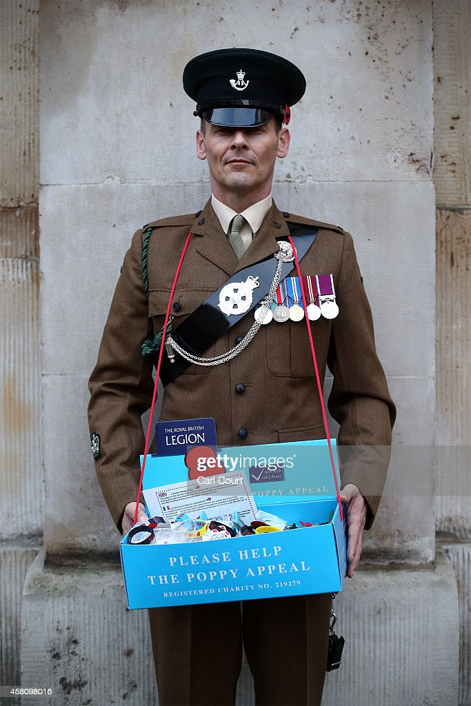 Sergeant Major Graham Perkins poses for a photograph as he volunteers for poppy appeal donations on October 30, 2014 in London, England. Volunteers throughout the UK are aiming to raise 40 million GBP this year to continue to fund support for the Armed Forces community.