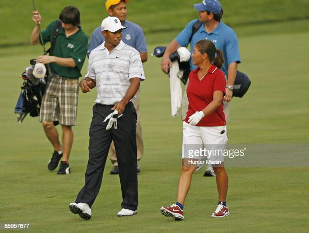 JULY 4 Sergeant Major Mia Kelly and Tiger Woods during the ATT National Earl Woods Memorial ProAm at Congressional Country Club on July 4 2007 in...