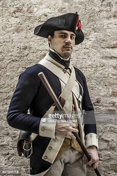 Sergeant of the 4th Massachusetts regiment wearing a tricorn hat and holding a baton American Revolutionary War 18th century Historical reenactment