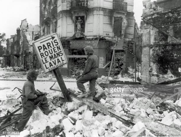 Sergeant Rainey and Lieutenant Rand, C Company, 2nd Battalion RUR. July 1944. Caen, Normandy, France.