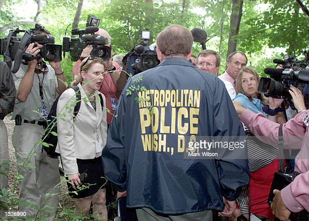 Sergeant Robert Panizari briefs reporters about the ongoing search in Rock Creek Park for missing intern Chandra Levy, July 16, 2001 in Washington,...