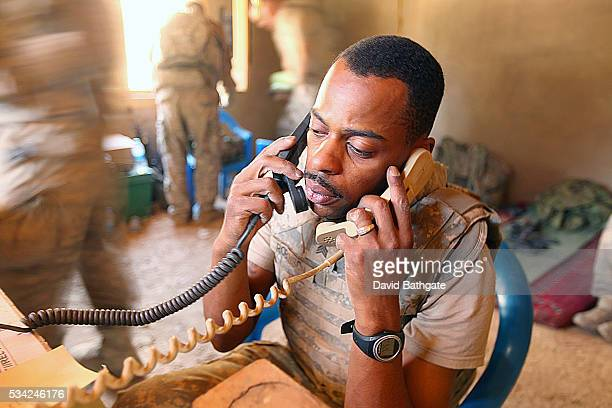 Sergeant Robinson of Charlie Company the US Army's 10th Mountain Division mans the radios during a Taliban attack on Firebase Lindstrom at Barge...