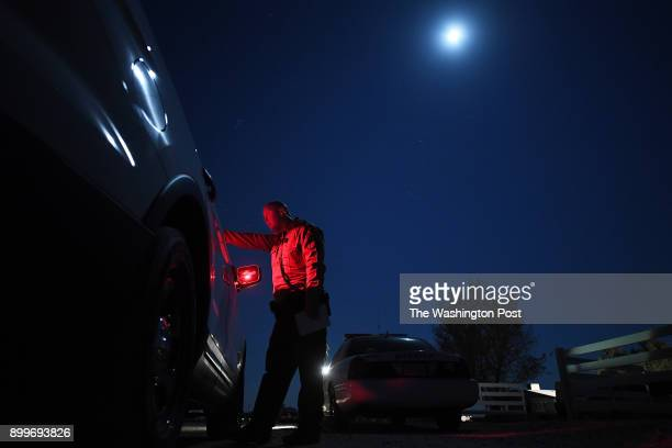 Sergeant Steve Wells of the Kern County Sheriff Department talks to fellow law enforcement personnel at the scene of a call involving a suicidal...