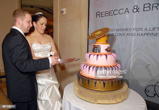 Sergeants Rebecca Hernandez and Brad Tarr of Manassas Virginia cut their wedding cake after being married by Rev Run of Run DMC at Rev Run's Rock 'n...