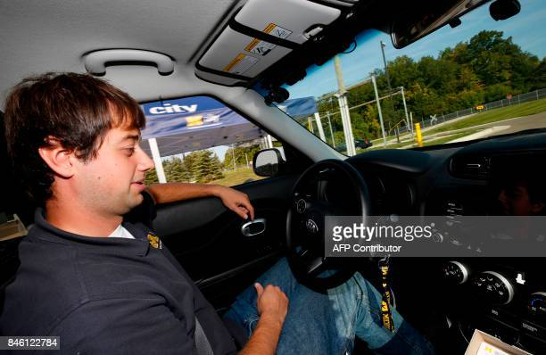 Sergei Abedisov drives a connected KIA Soul that offers vehicle to vehicle contact at the McityTest Facility on September 12 2017 in Ann Arbor...
