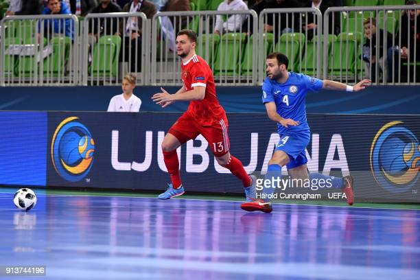 Sergei Abramovich of Russia and Taynan of Kazakhstan in action during the UEFA Futsal EURO 2018 group B match between Kazakhstan v Russia at Stozice...