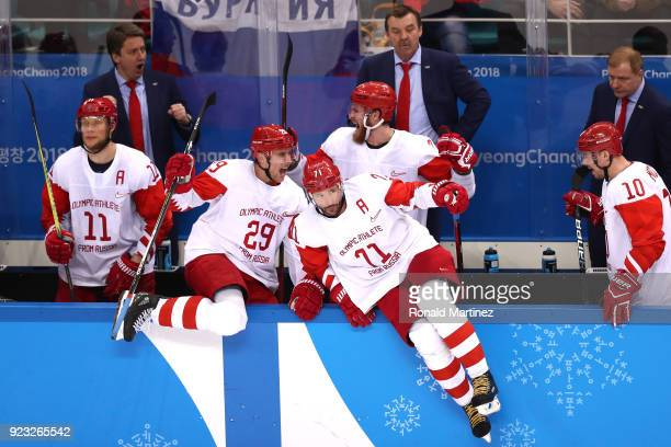 Sergei Andronov, Ilya Kablukov and Ilya Kovalchuk of Olympic Athlete from Russia celebrate after defeating Czech Republic 3-0 during the Men's...