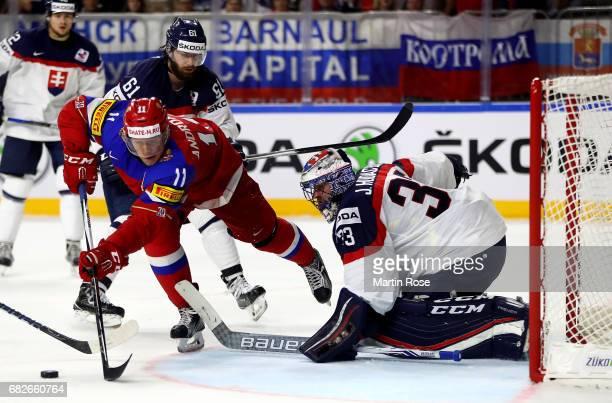 Sergei Andronov of Russia fails to score over Julius Hudacek, goaltender of Slovakia during the 2017 IIHF Ice Hockey World Championship game between...