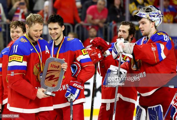 Sergei Andronov Russia celebrate with his team mates the bronze medal after the 2017 IIHF Ice Hockey World Championship Bronze Medal game between...