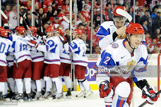 Sergei Barbashev of Team Russia celebrates with team mates after defeating Team Canada during the 2012 World Junior Hockey Championship Semifinal...