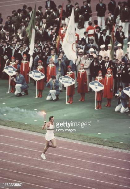 Sergei Belov of the Soviet Union runs with the Olympic Torch during the Opening Ceremony event for the XXII Olympic Summer Games on 19 July 1980 at...