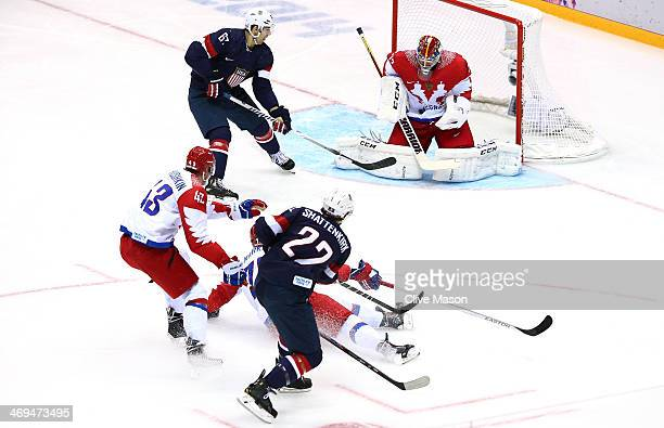 Sergei Bobrovski of Russia makes a save against Kevin Shattenkirk of the United States during the Men's Ice Hockey Preliminary Round Group A game on...