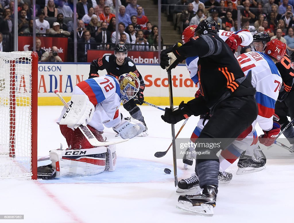 Sergei Bobrovsky #72 of Team Russia jumps on a loose puck with Jack Eichel #15 of Team North America in front during the World Cup of Hockey 2016 at Air Canada Centre on September 19, 2016 in Toronto, Ontario, Canada.