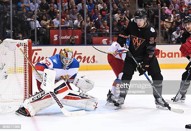 Sergei Bobrovsky of Team Russia makes a pad save with Auston Matthews of Team North America in front during the World Cup of Hockey 2016 at Air...