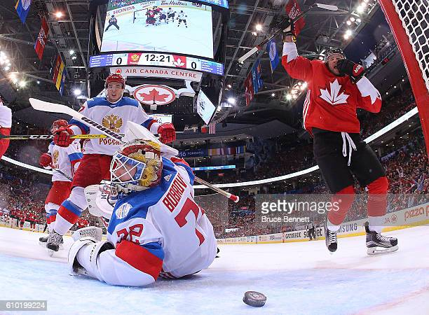 Sergei Bobrovsky of Team Russia reacts as Steven Stamkos of Team Canada celebrates the first period goal by teammate Sidney Crosby at the semifinal...