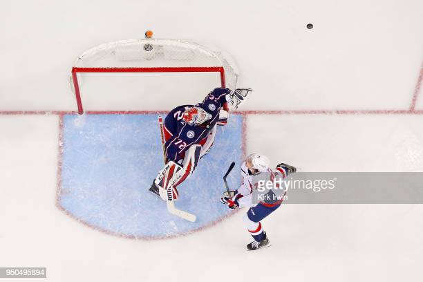 Sergei Bobrovsky of the Columbus Blue Jackets and TJ Oshie of the Washington Capitals follow the puck as it is deflected up in to the air in Game...
