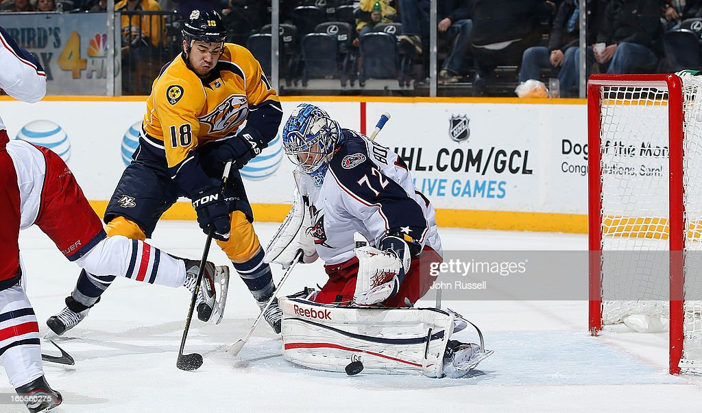 Sergei Bobrovsky #72 of the Columbus Blue Jackets blocks a shot against Brandon Yip #18 of the Nashville Predators during an NHL game at the Bridgestone Arena on April 4, 2013 in Nashville, Tennessee.