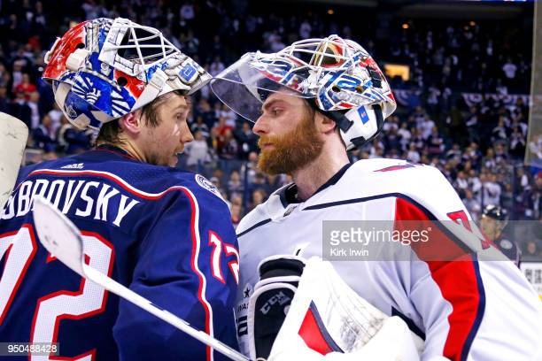 Sergei Bobrovsky of the Columbus Blue Jackets congratulates Braden Holtby of the Washington Capitals at the end of Game Six of the Eastern Conference...