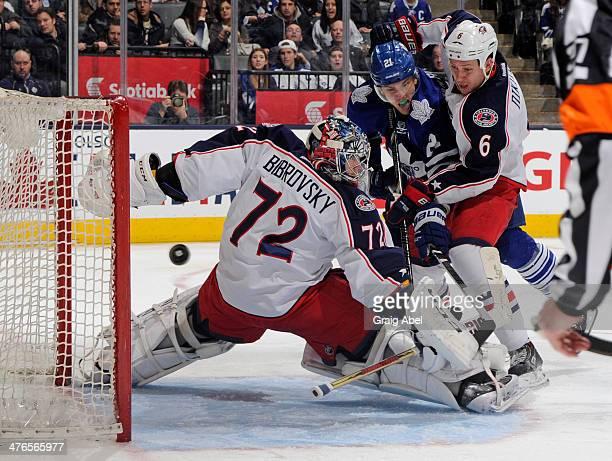Sergei Bobrovsky of the Columbus Blue Jackets defends the goal as teammate Nikita Nikitin battles with James van Riemsdyk of the Toronto Maple Leafs...