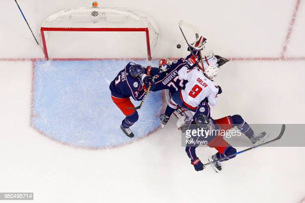 Sergei Bobrovsky of the Columbus Blue Jackets dives on a loose puck in an attempt to keep the puck from Dmitry Orlov of the Washington Capitals in...