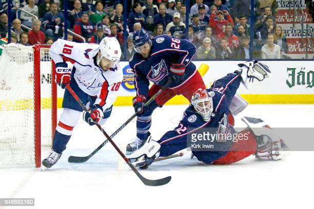 Sergei Bobrovsky of the Columbus Blue Jackets dives to block a shot from Chandler Stephenson of the Washington Capitals during the first period in...