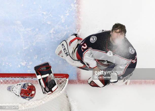 Sergei Bobrovsky of the Columbus Blue Jackets expels water prior to the start of the game against the New York Islanders at the NYCB Live's Nassau...