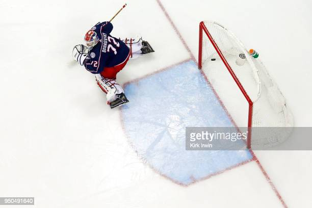 Sergei Bobrovsky of the Columbus Blue Jackets gets beat by a shot by Devante SmithPelly of the Washington Capitals during the third period in Game...