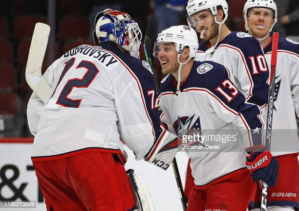 Sergei Bobrovsky of the Columbus Blue Jackets is congratulated by Cam Atkinson after a win against the Chicago Blackhawks at the United Center on...