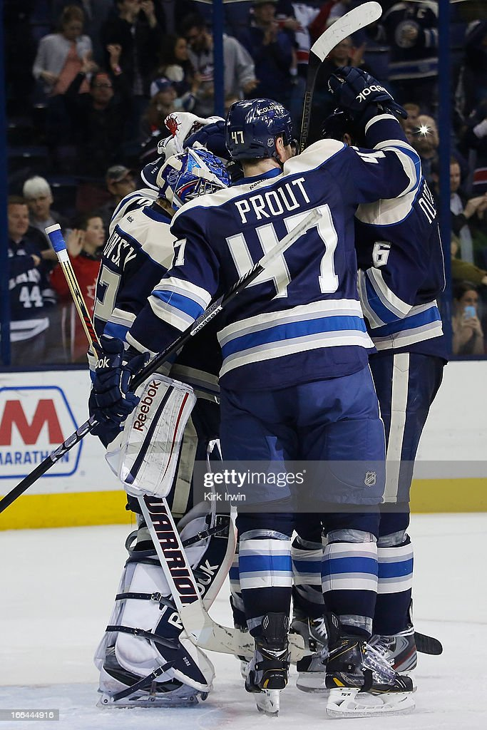 Sergei Bobrovsky #72 of the Columbus Blue Jackets is congratulated by teammates Dalton Prout #47, Nikita Nikitin #6, and Mark Letestu #55 after defeating the St. Louis Blues 4-1 on April 12, 2013 at Nationwide Arena in Columbus, Ohio.