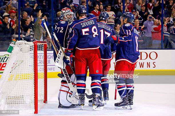 Sergei Bobrovsky of the Columbus Blue Jackets is congratulated by David Savard of the Columbus Blue Jackets after stopping 30 shots and defeating the...