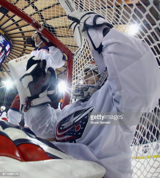 Sergei Bobrovsky of the Columbus Blue Jackets is pushed into the net during the third period against the New York Rangers at Madison Square Garden on...