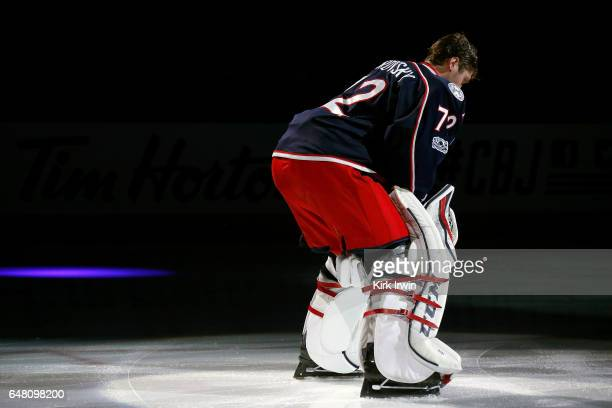 Sergei Bobrovsky of the Columbus Blue Jackets is spot lit during player introductions prior to the start of the game against the Minnesota Wild on...